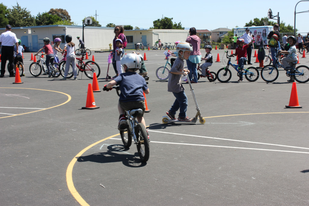Kids on bikes at a school