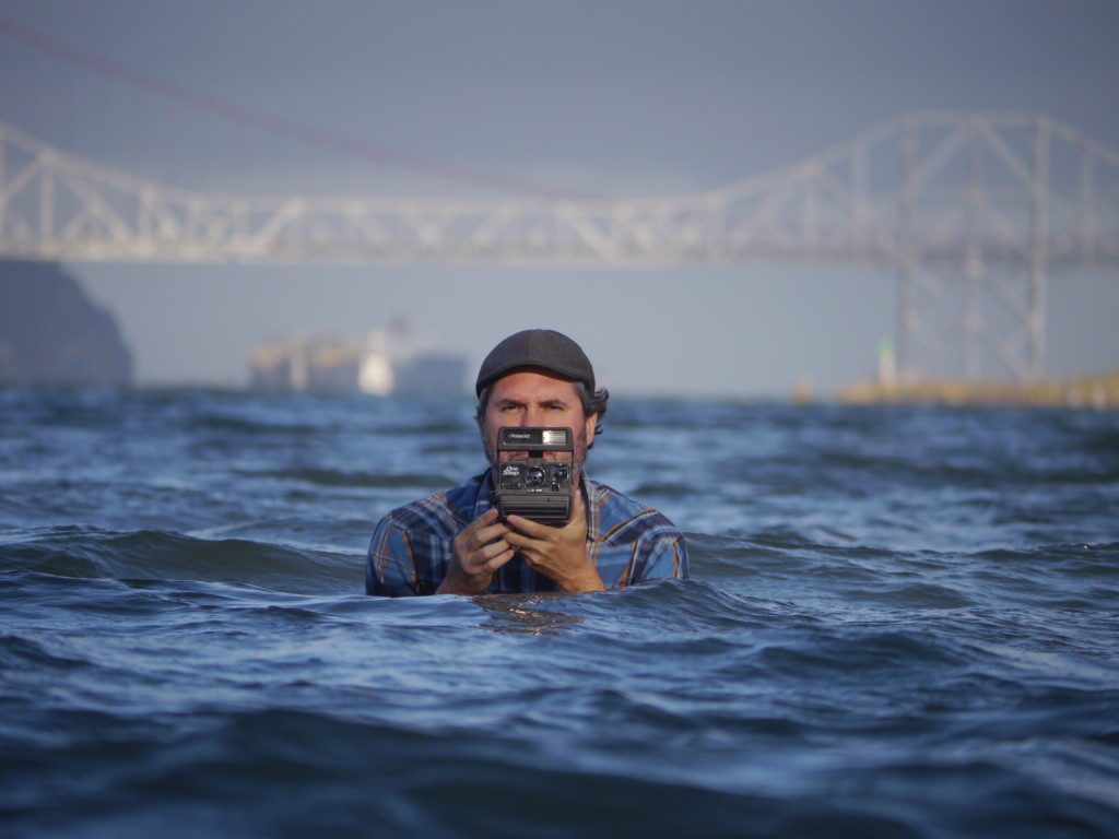 Photographer John Beck in Bay water