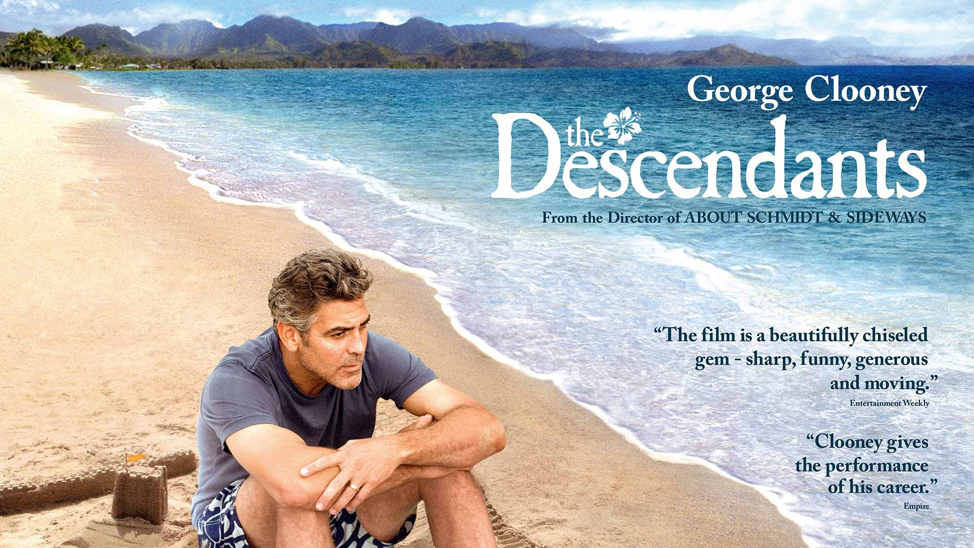 The Descendants movie image with George Clooney sitting on a beach