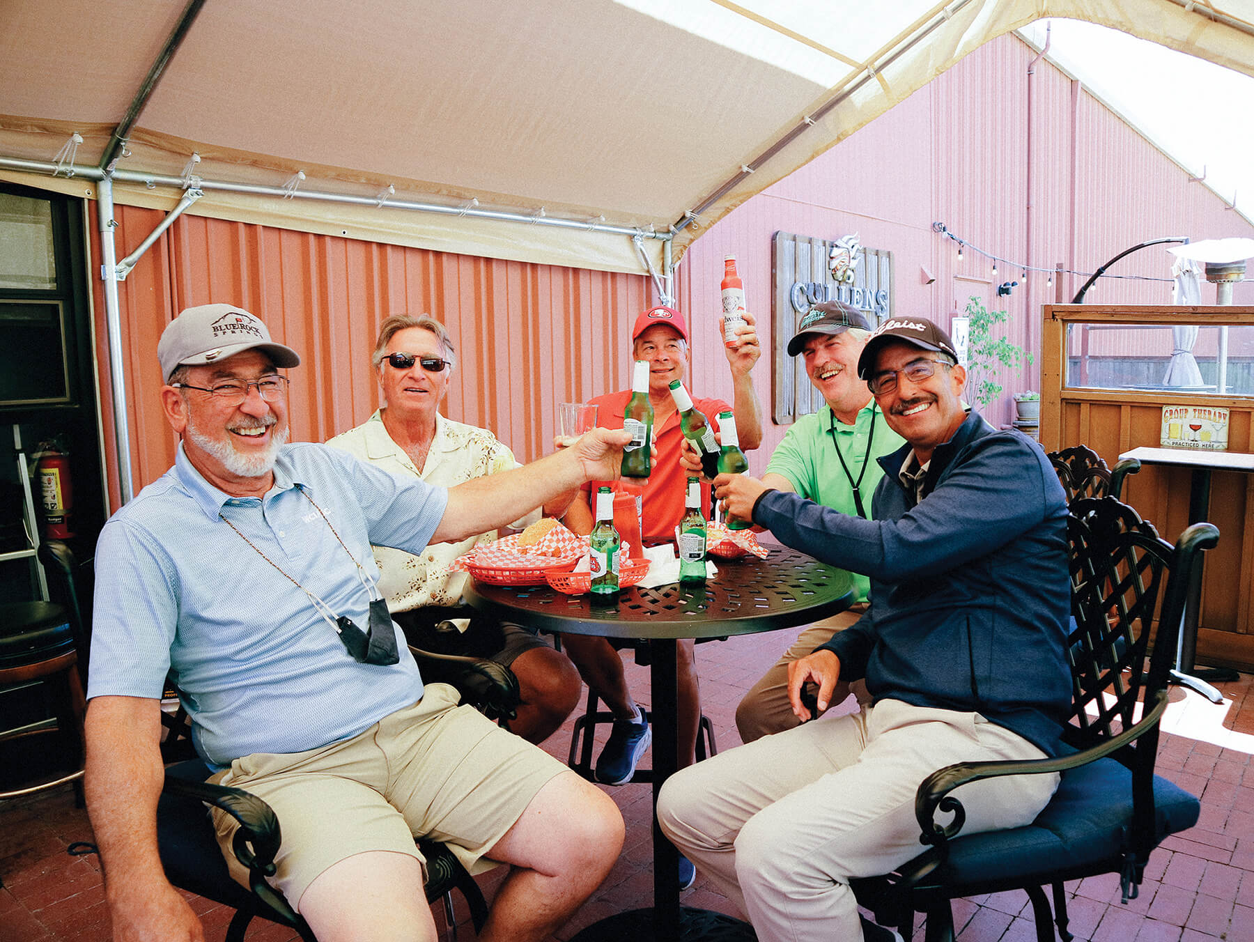 A group dining on Char's Hotdogs at Cullen's pub cheers