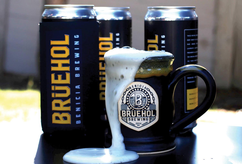 Bruehol beer, three crowlers and a mug overflowing with beer