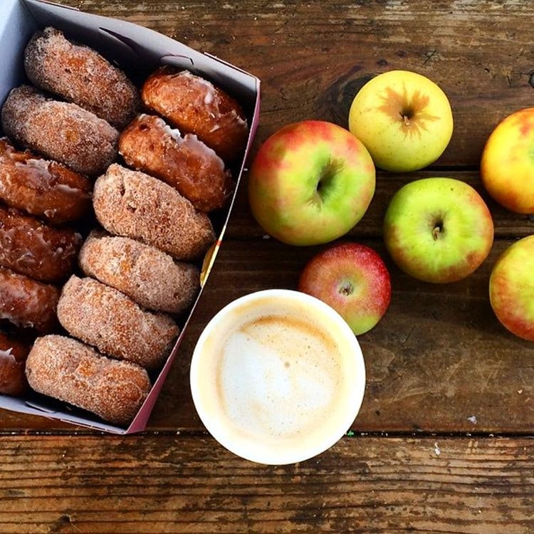 Apple Hill farms donuts and apples and a cup of apple cider