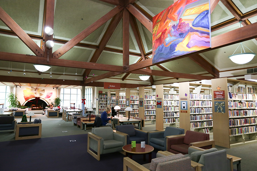 Benicia Public Library's reading room with public art and fireplace, photo by Malcolm Slight